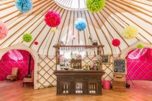 yurt with pom poms
